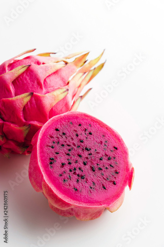 Fresh organic red dragon fruits on a white background