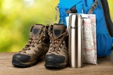 Hiking boots, backpack and map  on background - 242861994