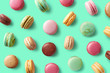Colorful french macarons on blue background