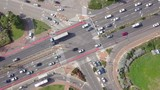 Top down aerial footage of traffic on a busy Junction with cars and trucks. - 242865397