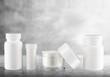 Leinwandbild Motiv Cosmetic containers isolated on background