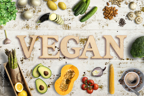 "Leinwanddruck Bild Word ""vegan"" in wooden letters with many cooking ingredients"