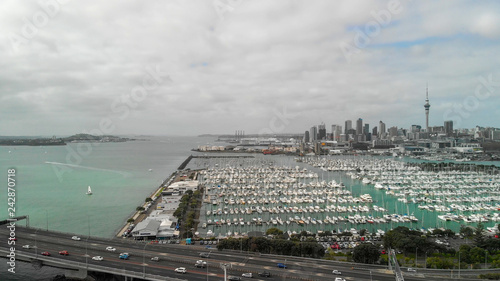 Aerial view of Auckland on a cloudy day, skyline and port, New Zealand