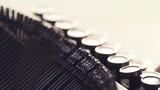 Close up of finger typing typewriter keyboard in slow motion - 242880354