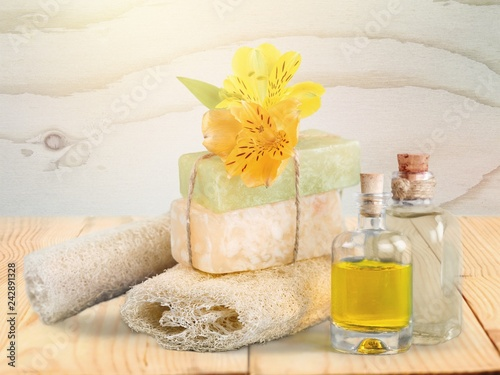 Healthy spa concept with handmade soap bars, oil bottles, sponge