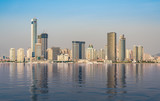Panorama of the city skyline of Xiamen in China with artificial ocean reflection - 242896199