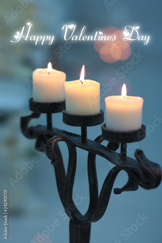 Three candles in a candlestick light valentines day