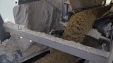 Processing of sand and ground. Machines working and conveyor line transporting sand. Open pit. Close up - 242904547
