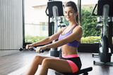 Woman doing exercise for her back - Seated cable row - 242907713