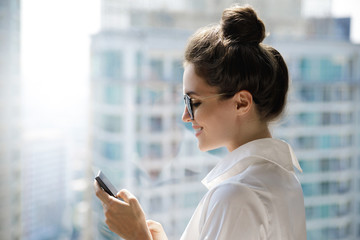 Young businesswoman using smartphone in her office © blackday