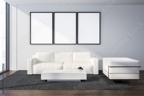 White office lounge area, posters