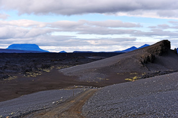 The road through volcanic landscape in Central Highlands of Iceland