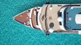 Aerial top view photo of huge liner cruise ship docked in tropical exotic mediterranean bay with turquoise sea - 242917562