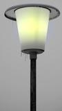 Gelb leuchtende Laterne mit Eiszapfen vor grauem Winterhimmel - 242921918