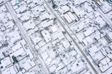 aerial view of rooftops under snow. winter urban background