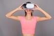 Quadro Happy woman using VR glasses for virtual reality experience