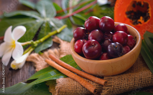 Foto Murales Mature fruits of plum house (Prunus domestica L.) on wooden background.
