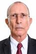 Face of senior businessman wearing eyeglasses isolated against white background