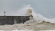 Quadro Stunning dangerous high waves crashing over harbor wall during windy Winter storm at Newhaven on English coast