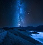 Milky way over foggy valley in the Castelluccio, Umbria, Italy