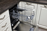 The Open dishwasher built into the kitchen - 242972974