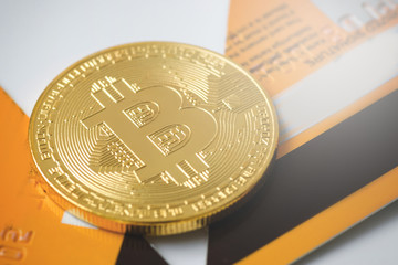 Bitcoin and broken credit card on white background © blackday