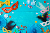 Carnival or mardi gras background with carnival masks, beards and photo booth props. - 242997723