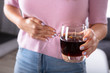 Woman Having Stomach Pain Holding Glass Of Drink