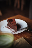 One slice of vegan chocolate brownie cake on wooden table. Sugar free, wheat free, dairy free, flourless dessert. Dark mood food photo. Healthy eating, lifestyle concept. Copy space - 243006527