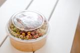 Take away salad in disposable paper bowl - 243007181