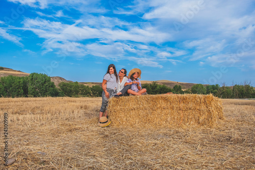 mother with daughters in the field smiling
