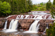 The waterfall in Lepreau, New Brunswick, Canada. Long exposure. Overcast day in summer.