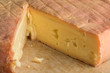 Piece of French Munster cheese closeup