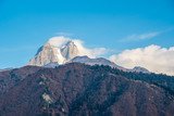 Two high rocky summits of Ushba mountain in Svaneti region of Georgia - 243027511