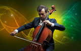 Serious classical cellist with fabled sparkling wallpaper - 243028799