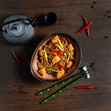 Japanese Cuisine - Udon (thick wheat noodles) with Salmon and Vegetables. Wooden background