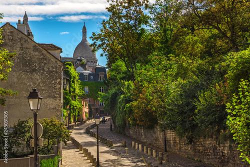old cozy street in quarter Montmartre in Paris, France. Cozy cityscape of Paris