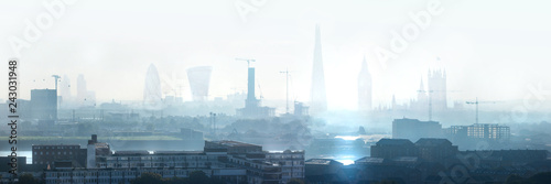 mata magnetyczna London view the morning. Panorama include river Thames, Big Ben and houses of Parliament, City of London buildings in the early morning mist.