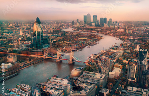 London view at sunset. Panorama include river Thames, Tower bridge and City of London and Canary Wharf  buildings. - 243031968