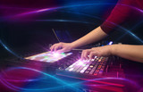 Hand mixing music on midi controller with wave vibe concept  - 243036169