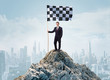Leinwanddruck Bild - Successful businessman on the top of a city holding goal flag