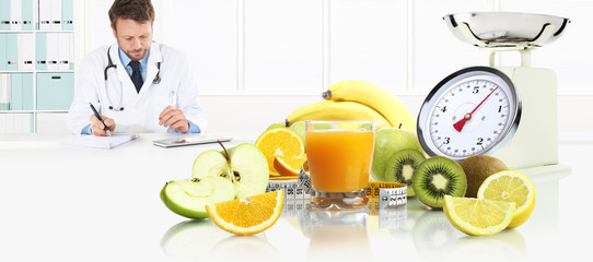 dietitian nutritionist doctor prescribes prescription by consulting the digital tablet at the desk office with fruits, glass juice, tape meter and scale healthy and balanced diet concept