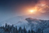 Dramatic winter landscape in mountains at sunset. Fantastic wintry scene.View of colorful sky glowing by sunlight. National Park Carpathian. Ukraine. Europe.