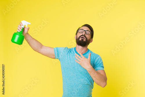 Leinwandbild Motiv Refresh concept. Bearded man with eyeglasses refresh sprinkling water. Man refresh with spray bottle yellow background. Time to refresh yourself. Heat season. Hot and thirst. On guard of freshness