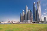 Luxury Dubai Marina skyscrapers and nature around green park, United Arab Emirates