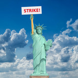 Strike in USA concept. Statue of Liberty and sign with space for text - 243046772