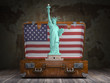 Statue of liberty and vintage suitcase with flag of USA. Travel and tourism  to NY New York city and USA concept.