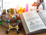 Chemistry .Laboratory equipment microscope with flasks, vials and model of molecule and book of chemistry. - 243047700