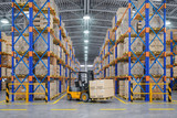 Forklift truck in warehouse or storage and shelves with cardboard boxes. - 243048913