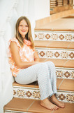 Outdoor portrait of beautiful young girl sitting on stairs - 243062359